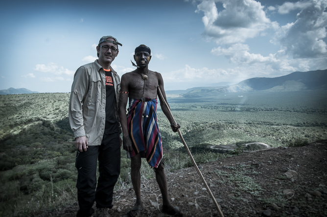 With a man from the Mursi tribe on a photo tour in Ethiopia