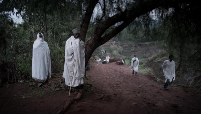 Two men photographed when praying at Lalibela