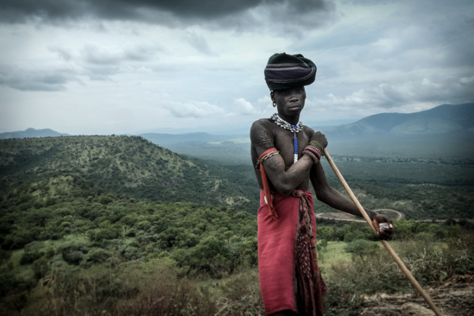 Mursi standing near the road on a Nomad Photo Expedition Ethiopia Photo Tour