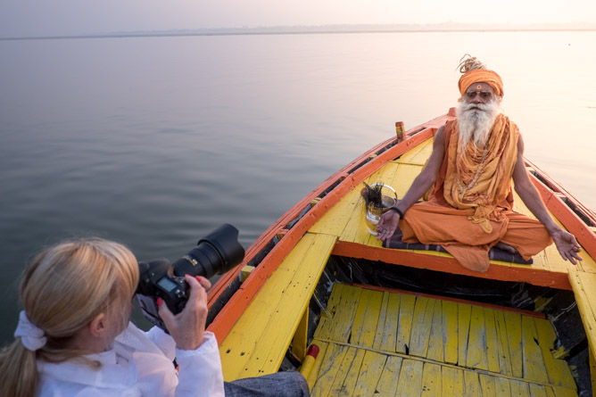 A customer taking photos at Varanasi