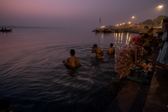 Pilgrims taking a sacred bath India