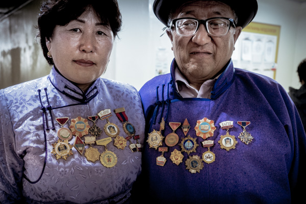 A Mongolia couple wearing proudly their medals