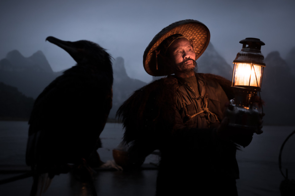 Fisherman in China with his cormorant