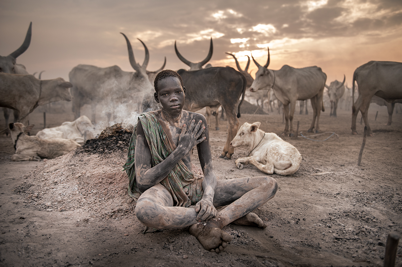 Boy seated on a Sudan Photo Tour